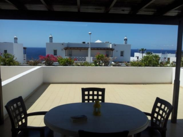 The terrace through the picture window - 27 Lago Verde, Puerto del Carmen, Lanzarote